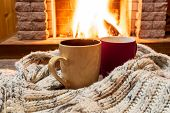 Two Cups For Hot Tea Or Coffee And Cozy Warm Scarf Near Fireplace, In Country House, Winter Vacation poster