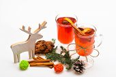 Winter Hot Drinks Concept. Mulled Wine Or Hot Beverage In Glasses With Cinnamon Sticks And Fir Cone. poster