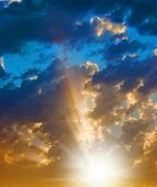 picture of brighten  - rays of light in the cloudy sky at the sunset - JPG