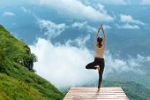 Healthy Woman Lifestyle Exercising Vital Meditate And  Practicing Yoga At  The Bridge In Morning The poster