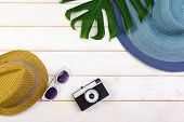 Beachwear And Accessories On A White Wooden Background poster