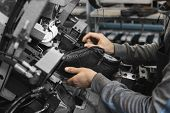 Man Use Special Machine Tool For Making A Shoes. The Conveyor On A Shoes Factory With Shoe And Sole. poster