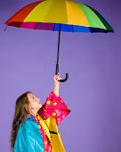 Waterproof Accessories For Children. Kid Girl Happy Hold Colorful Umbrella Wear Waterproof Cloak. En poster