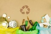 Metal Glass Paper Recycle Concept, Brown Recycle Symbol Sign With Sorted Metal Cans And Jars, Glass  poster