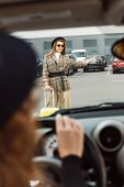 Partial View Of Woman Sitting At Steering Wheel While Stylish Female Tourist Doing Thumb Up Gesture  poster
