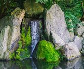 Beautiful Waterfall With Streaming Water With Big Stones And Some Covered With Green Moss Peaceful N poster