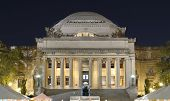 stock photo of neo-classic  - The Library of Columbia Universary with crowds below for a festival in New York City - JPG