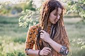 Portrait Of Beautiful Hippie Woman With Dreadlocks In The Woods At Sunset Having Good Time Outdoors poster
