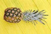 Fresh Pineapple On Colorful Wooden Background. Tropical Ananas Fruit On Yellow Wooden Table. poster