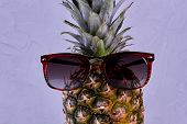 Pineapple Wearing Sunglasses Close Up. Funny Ananas In Sunglasses On Grey Background. Summer Vacatio poster
