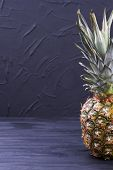 Healthy Pineapple Fruit And Copy Space. Delicious Organic Ananas On Black Wooden Background. Benefit poster