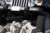 stock photo of off_road  - four wheel drive vehicle clicking up a rocky hillside trying to make it to the top of the hill - JPG