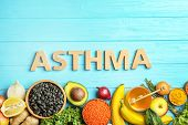 Flat Lay Composition With Natural Products As Home Remedies And Word Asthma On Wooden Background poster