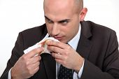 stock photo of hustle  - bad man smelling money - JPG