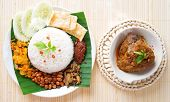 stock photo of nasi  - Nasi lemak is traditional malaysia spicy rice dish - JPG