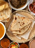 Indian bread, Chapati flatbread, roti canai, dal, curry, teh tarik or pulled tea, acar. Famous india