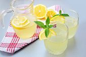 image of elderflower  - Pitcher and glasses of refreshing elderflower drink with lemon and mint - JPG