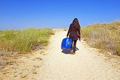 Young woman travelling to her holidays destination poster
