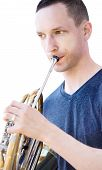 Caucasian Male Musician Playing Horn Isolated On White