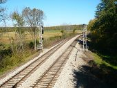 stock photo of amtrak  - Train tracks going down far in the distance - JPG