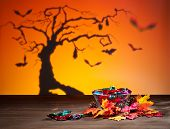 stock photo of auburn  - Halloween tree bats sweets and golden leafs - JPG
