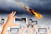 stock photo of meteorite  - People taking photos of falling meteorite on mobile phone camera - JPG