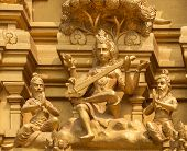 stock photo of saraswati  - Detail of statues on the golden entrance tower at Sri Naheshwara in Bengaluru - JPG
