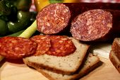 foto of eatables  - Meat sausage salami with pepper and brown bread - JPG