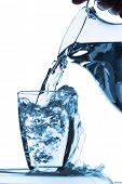 stock photo of pitcher  - pure water is emptied into a glass of water from a pitcher - JPG
