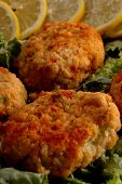 stock photo of crab-cakes  - crab cakes lemon garnish - JPG