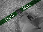 picture of fresh start  - Man walking across a green line with words fresh start - JPG