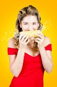 stock photo of zea  - Fun old fashioned portrait of a retro pinup girl eating corn on the cob with juicy splashes of GMO free goodness - JPG