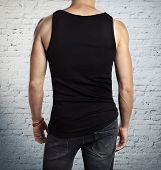 image of vest  - Man wearing black vest - JPG