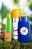 image of mosquito repellent  - Bottles with mosquito repellent cream on nature background - JPG