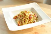 pic of carbonara  - Spaghetti Carbonara with bacon serve on white modern plate