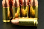 stock photo of 9mm  - 9mm copper rull metal jacket bullet pistol Ammunition - JPG