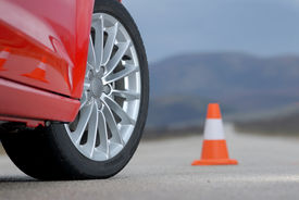 picture of designated driver  - aluminium sport wheel on a red sport car and cone - JPG