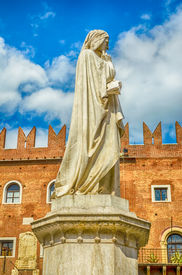 stock photo of alighieri  - Monument for Dante Alighieri at the Piazza dei Signori in Verona Italy - JPG