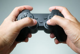 picture of controller  - Video game console controller in gamer hands - JPG