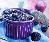 stock photo of blackberries  - jam from fresh blackberry and sugar, fresh blackberry jam ** Note: Shallow depth of field - JPG