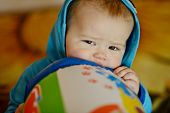 picture of love bite  - baby biting toy in soft selective focus - JPG