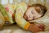picture of pajamas  - sleeping toddler girl is wearing a pajama - JPG