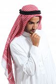 picture of arab man  - Arab saudi emirates man thinking and looking down isolated on a white background - JPG