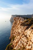stock photo of grotto  - high cliffs and sea Neptune Grotto in Sardinia Italy - JPG