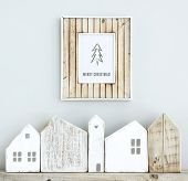 picture of scandinavian  - MERRY CHRISTMAS scandinavian or american style room interior with wooden frame and handmade small houses - JPG