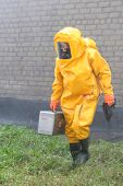 pic of decontamination  - Man in chemical protection suit carrying out the decontamination area