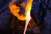 stock photo of furnace  - Melted glass flows out from the furnace - JPG