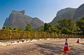 stock photo of gneiss  - Mountain Road with Pedra da Gavea and Pedra Bonita Rocks in the Horizon in Rio de Janeiro - JPG
