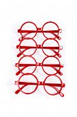 image of bifocals  - Stack of red glasses isolated on white - JPG