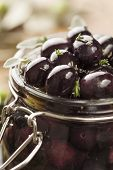 foto of kalamata olives  - jar with pickled kalamata olives - JPG